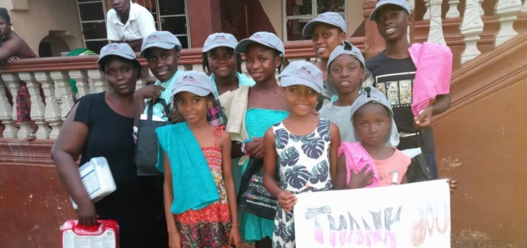Ebola orphans with new school supplies