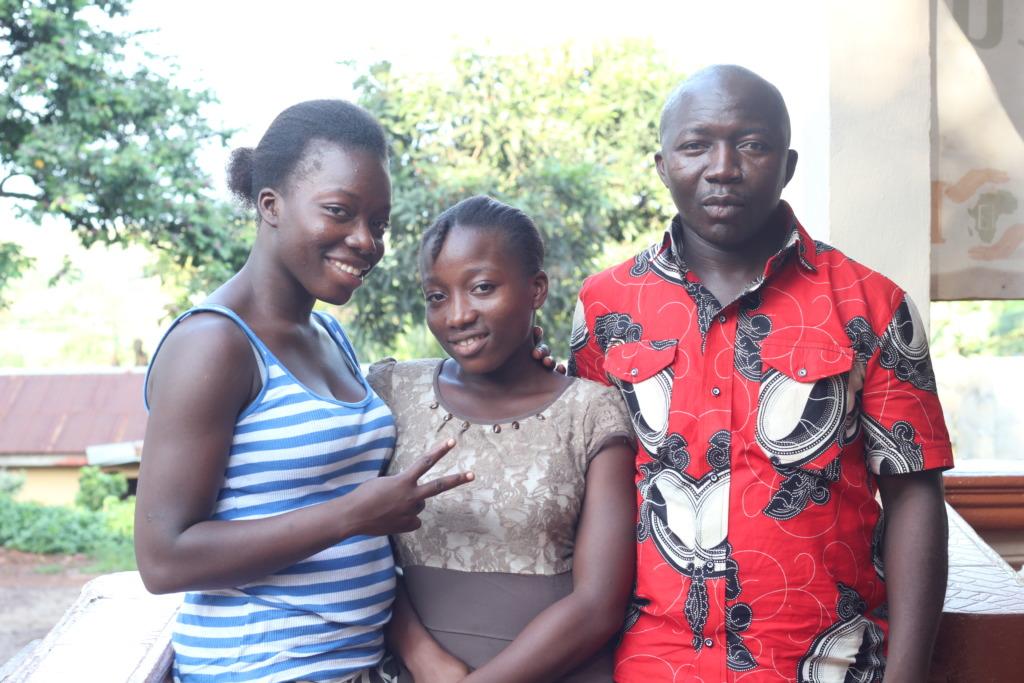 Geraldine, Dorcas and Joshua - outside the Home