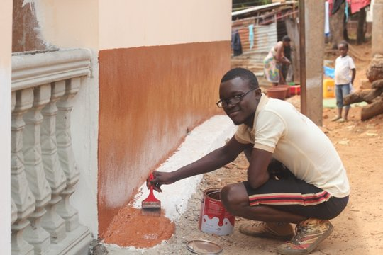 Alfred a volunteer - painting orphanage