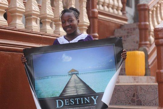Dorcas holding a Poster about Destiny