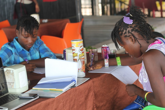 family takes notes and makes individual vision