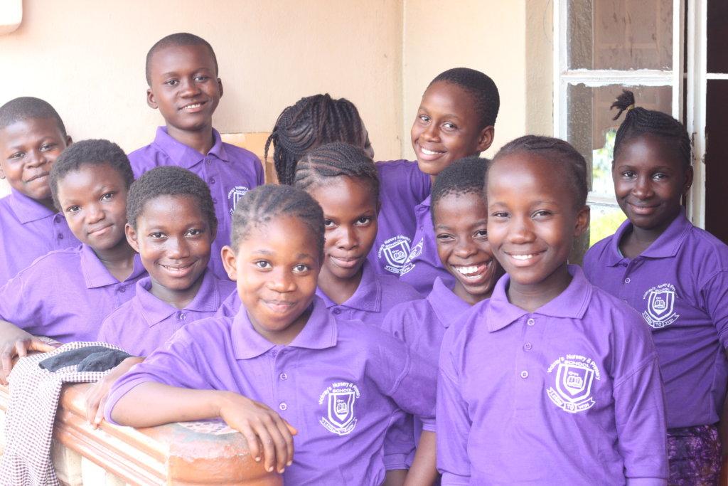 Kids outside Dream Home in uniform