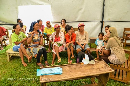 KI volunteer working with survivors in Guiuan