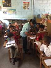 Secondary school students teaching primary school