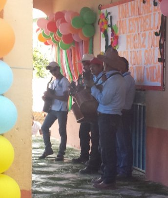 The students serenade the mothers