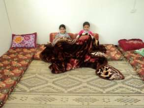 Mustafa's children with blankets from kit.