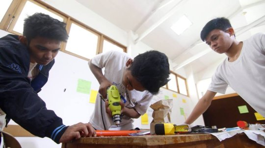 Students constructing an instrument