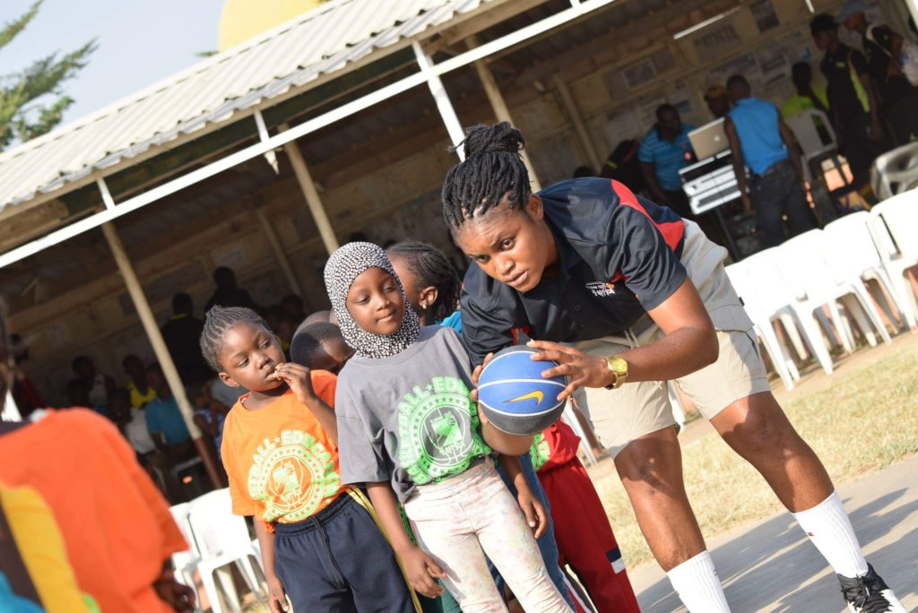 Kids and our Ms Ebere, learning the basics