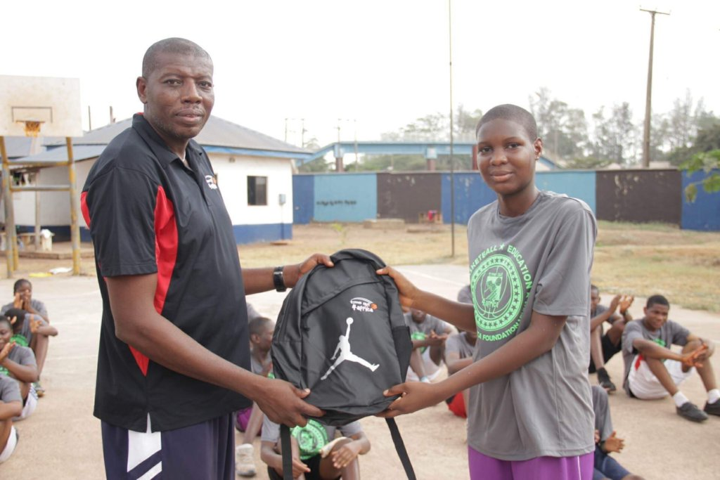 Coach Chiedozie with one of our winners