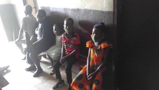 Children await their injections