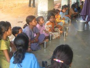 Children getting soymilk - Mathikai school