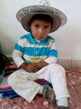 Bolivian boy in large hat at clinic