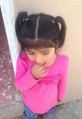 Bolivian girl in pink with pigtails