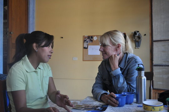 Founder Sandy Kemper spending time with a student