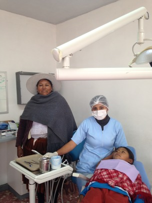 Theodora with daughter Lydia receiving treatments