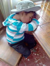Sleeping Bolivian boy awaits dental care