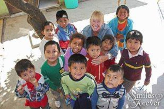 Smiles Forever Founder Sandy with lucky children
