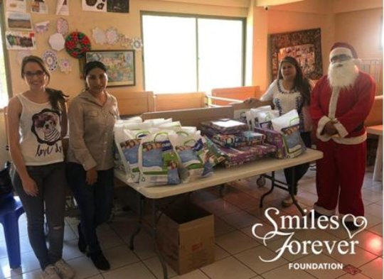 Smiles Forever Santa brings care packages