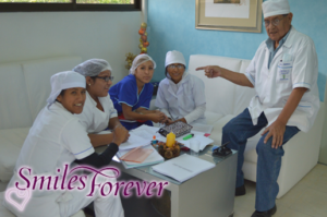 Smiles Forever students studying with elder