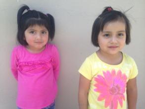 Girls in pink & yellow receive dental screening