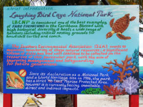 New educational signage for Laughing Caye