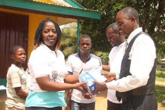 Program Officer Handing Over Thermometers