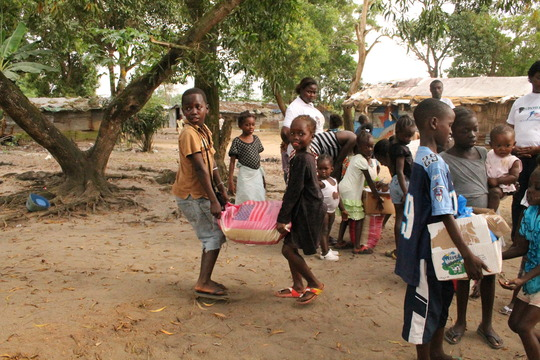 Ebola survivor children happily collect food