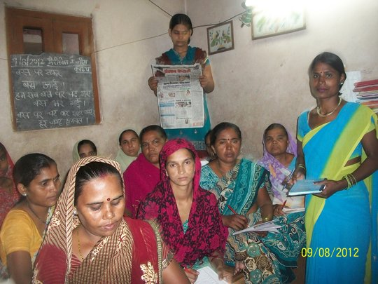 Adult Literacy Centre- women reading newpapers
