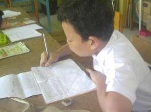 Yeremia is writing the homework