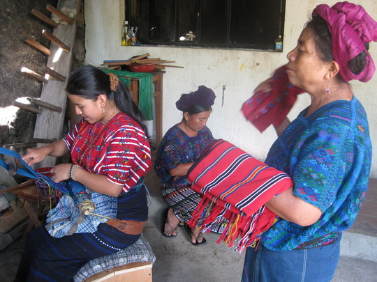 Estela on the ergonomic bench, weaving