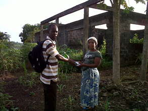 Farmer receiving seeds from project partner.