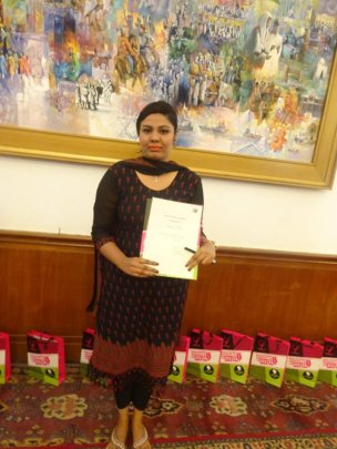 Maica with her certificate for her Educate a Girl