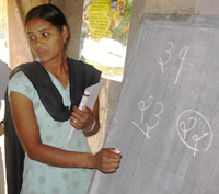 A schoolteacher in a classroom funded by NYOF