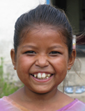 A girl in rural Nepal who is supported by NYOF