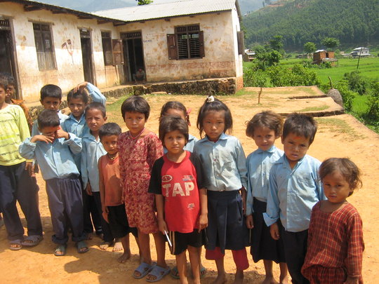 Students in a rural village lining up for school
