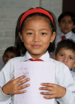 Young Student Learning to Write