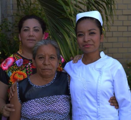 Naty with her mother and Adela Toledo.