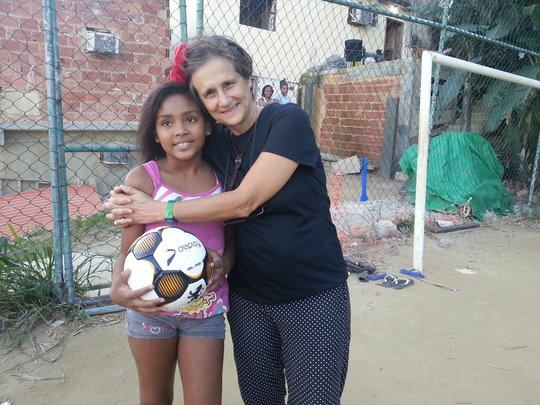 Young girls are tuned into football