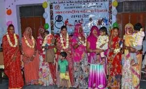 Women's warm welcome by Village Leader