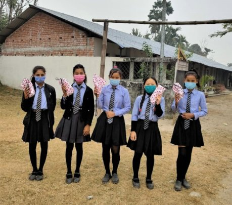 Students carrying pack of reusable sanitary pads