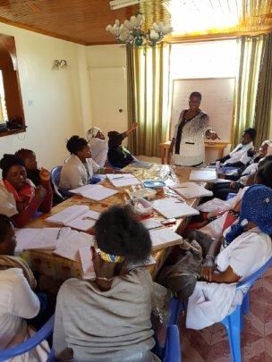 A volunteer running a class on business management