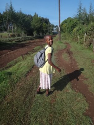 Mary heading off to school.