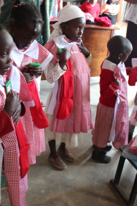 Little girls getting their new uniforms