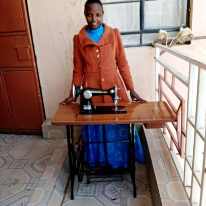 Susan proudly showing her new sewing machine.
