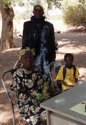 Alimata with her grandparents