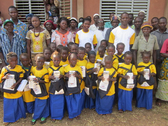 Moutoulou village girls with teachers and parents