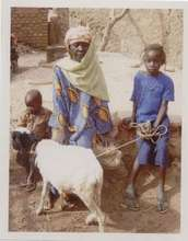 Babita Ouedraogo with her grandmother and her lamb