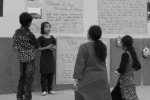 Sabeena explaining the details of her community