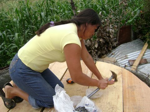 Guadalupe working on the cover for the cistern