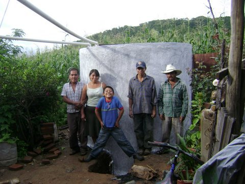 The Aragon Rios family proudly standing next to the completed ci